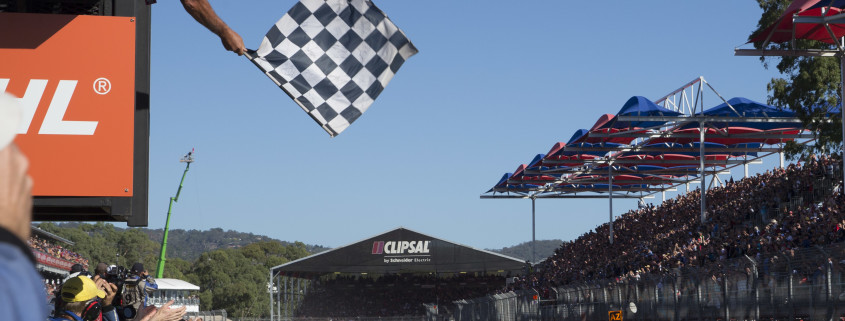 Car 22 taking the chequered flag at an action packed Clipsal 500 event.